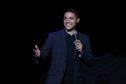 Comedian Trevor Noah performs on stage